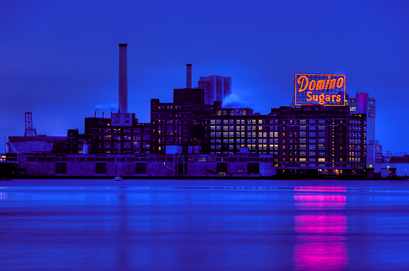 neon glow of the Domino Sugars sign