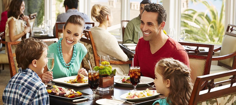 family eating at restaurant - 1240×550